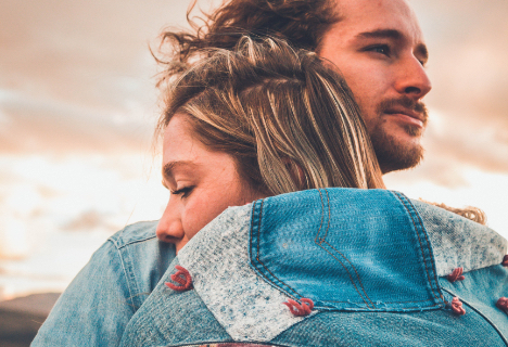 Young couple hugging, behavioral health